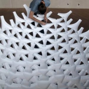 UNDULATUS: design and fabrication of a self-interlocking modular shell structure based on curved-line folding