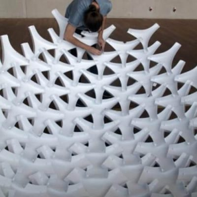 UNDULATUS: design and fabrication of a self-interlocking modular shell structure based on curved-line folding