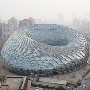 Doughnut-shaped television studio in Beijing is enclosed in a latticed shell