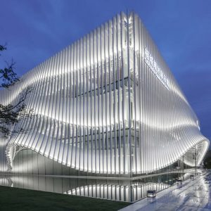 lacime architects cover exhibition hall with undulating facade in suzhou, china