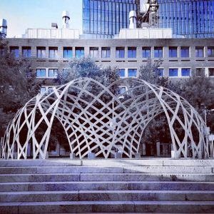 Inframe elastic timber gridshell